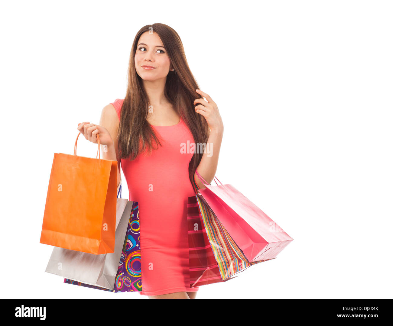 Beautiful young woman with shopping bags, isolated on white - Stock Image