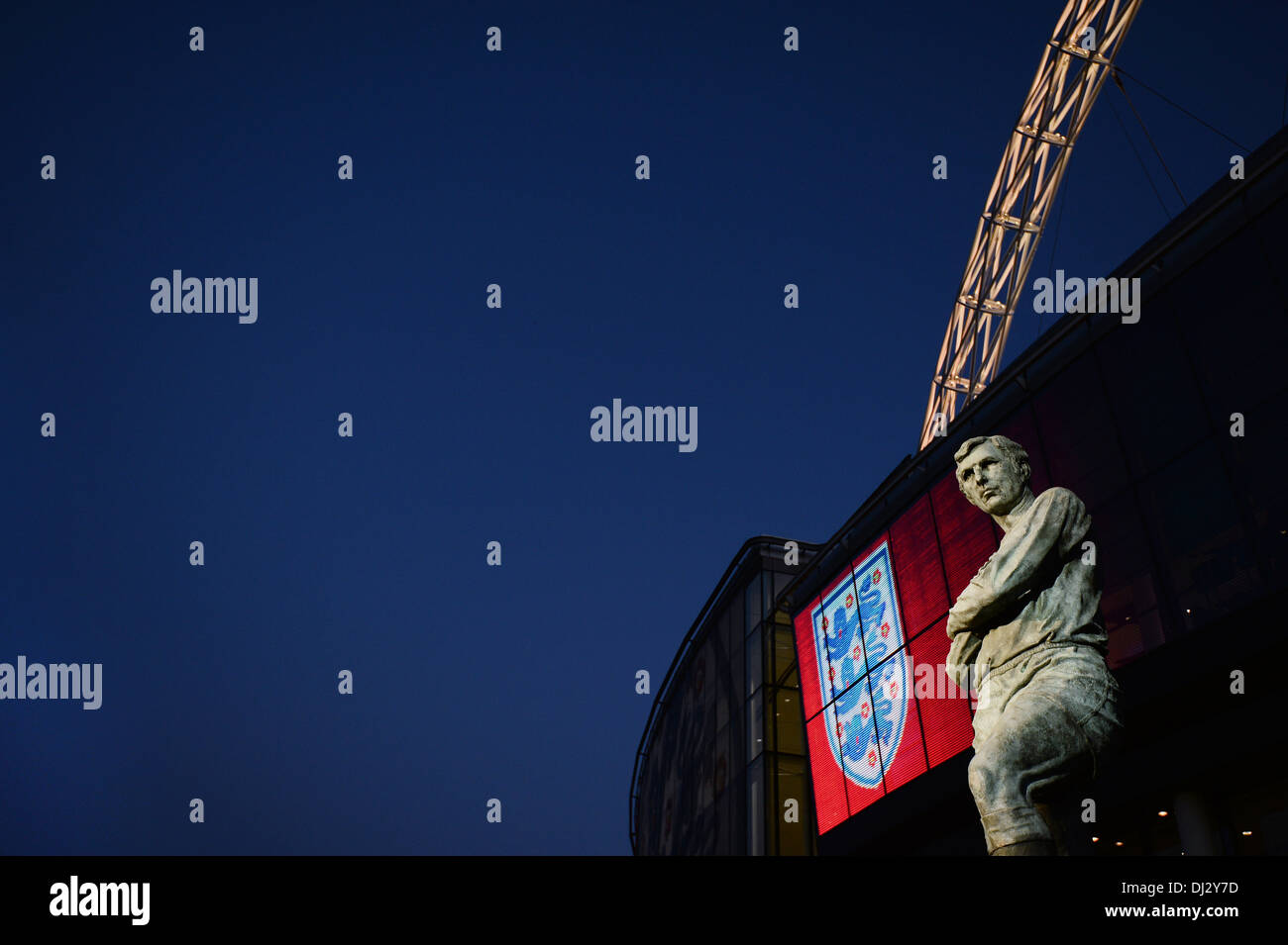 The Bobby Moore Statue at Wembley Stadium pictured in front of the famous arch and three lions - Stock Image