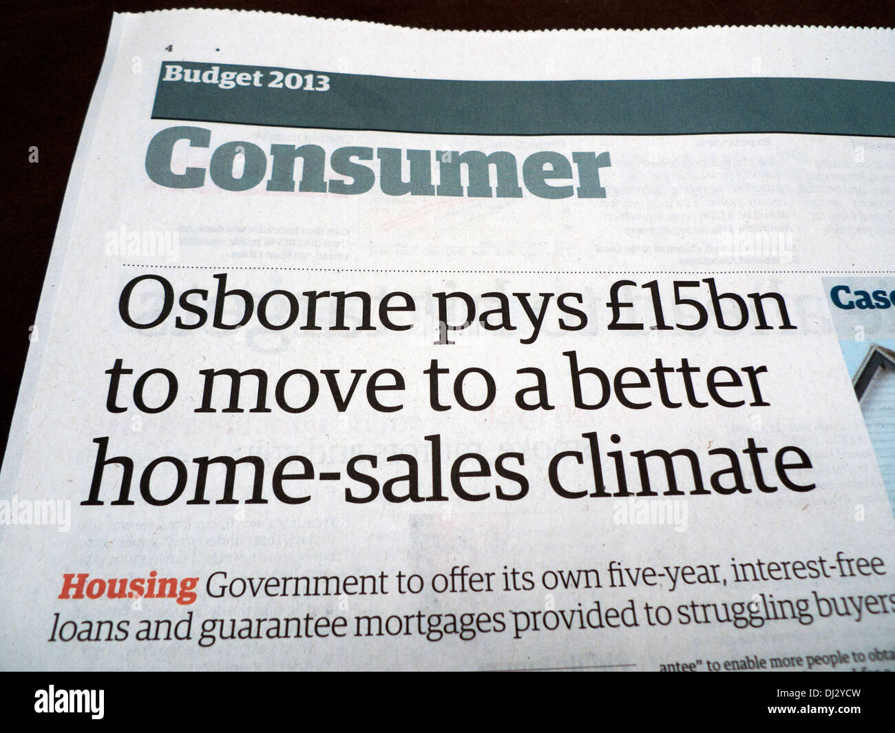 """""""Osborne pays £15bn to move to a better home-sales climate"""" article in Guardian 2013 Budget Special Consumer section Stock Photo"""