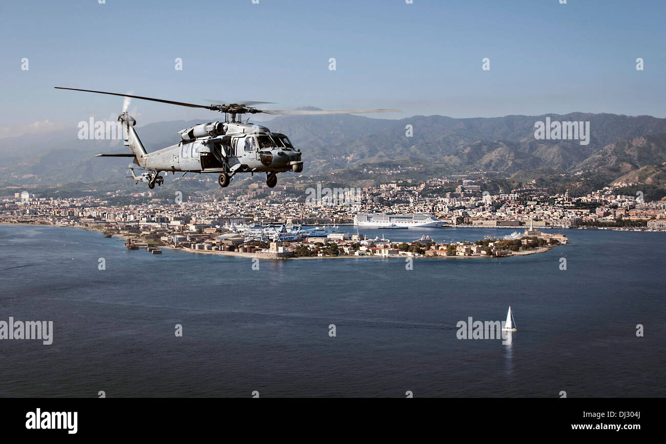 US Navy MH-60S Sea Hawk helicopter flies along the coast October 29, 2013 of Naples, Italy. - Stock Image
