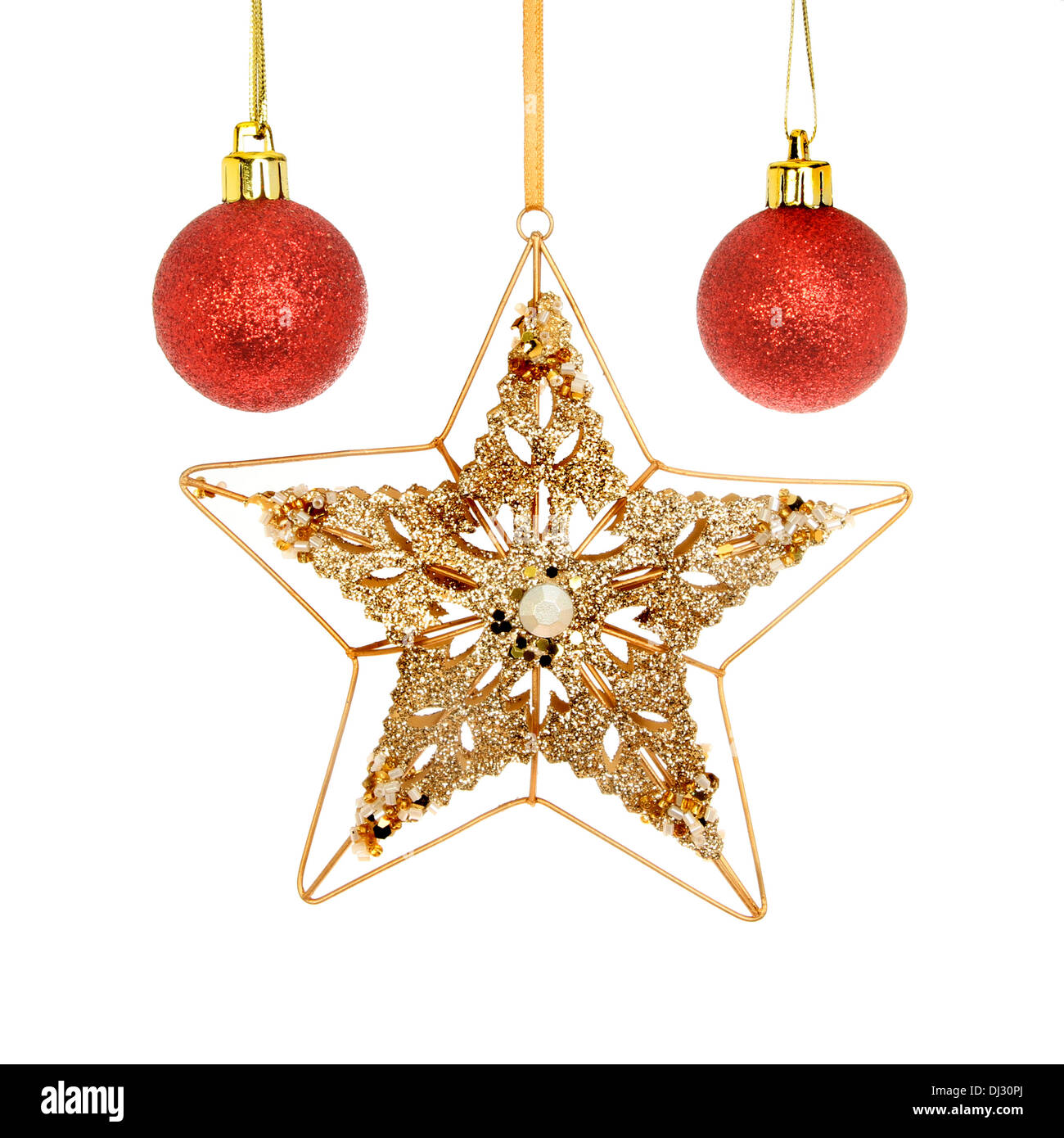 6dbca741b201 Gold, glitter and jeweled Christmas star with red baubles isolated against  white