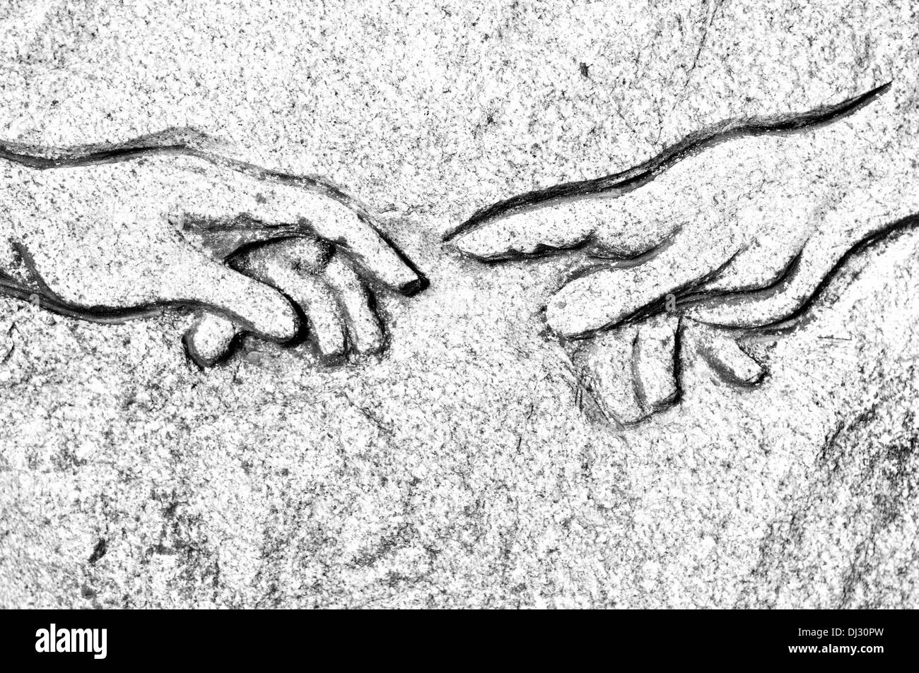 Michelangelo's Creation of Adam in stone Stock Photo