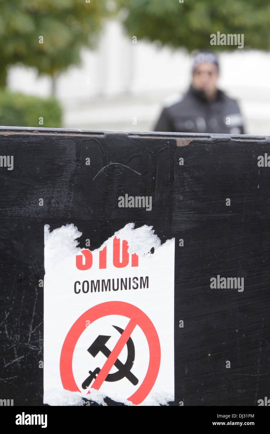 Sofia, Bulgaria; 20 November 2013. Sticker ' Stop Communism' on the barrier in front of the parliament. That barrier is now closing off the building for more than five months.   (Credit: Johann Brandstatter / Alamy Live News) - Stock Image