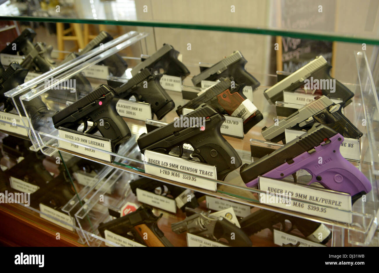 Hand guns on display in a store in small town middle America - Stock Image
