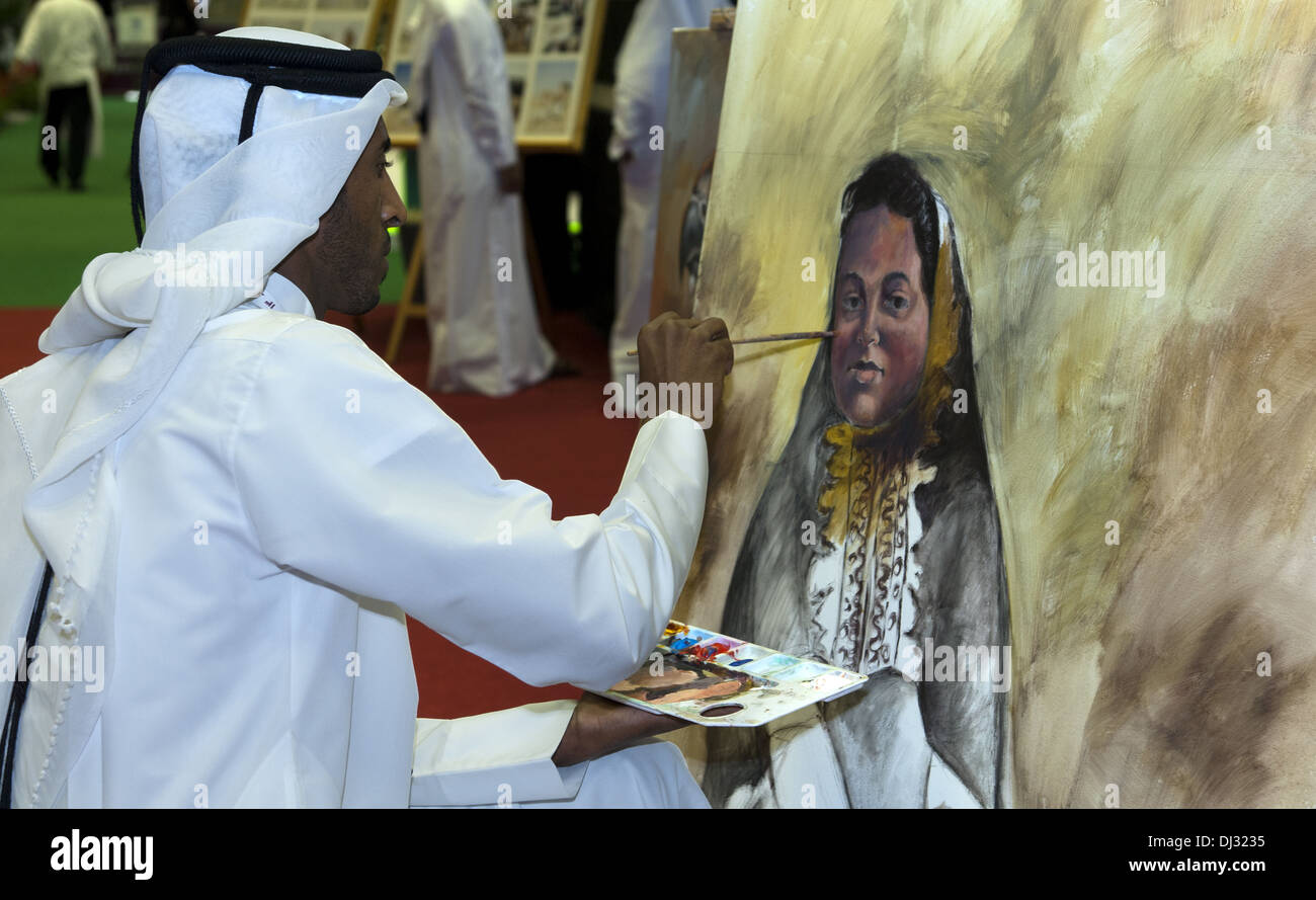 Arab painter in traditional dishdash garments - Stock Image