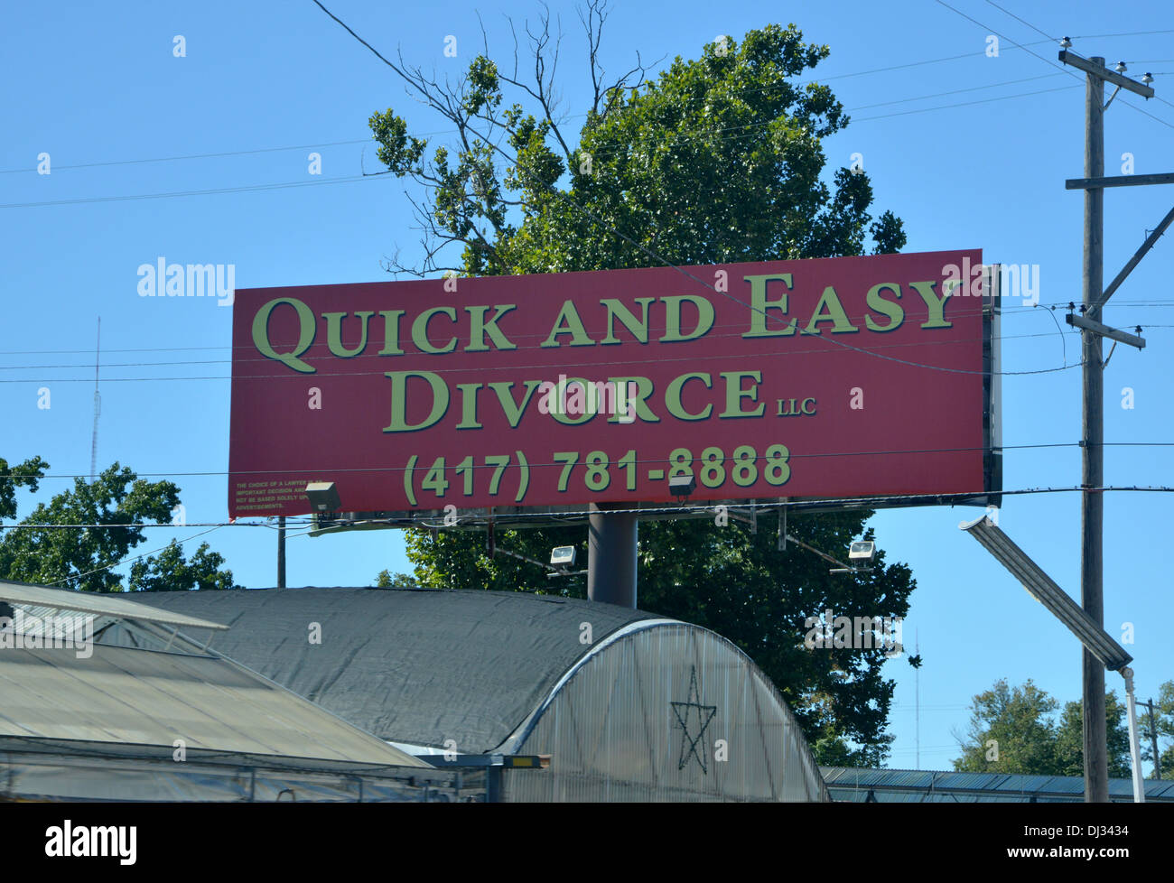 Quick and Easy Divorce advert sign on a building in America - Stock Image