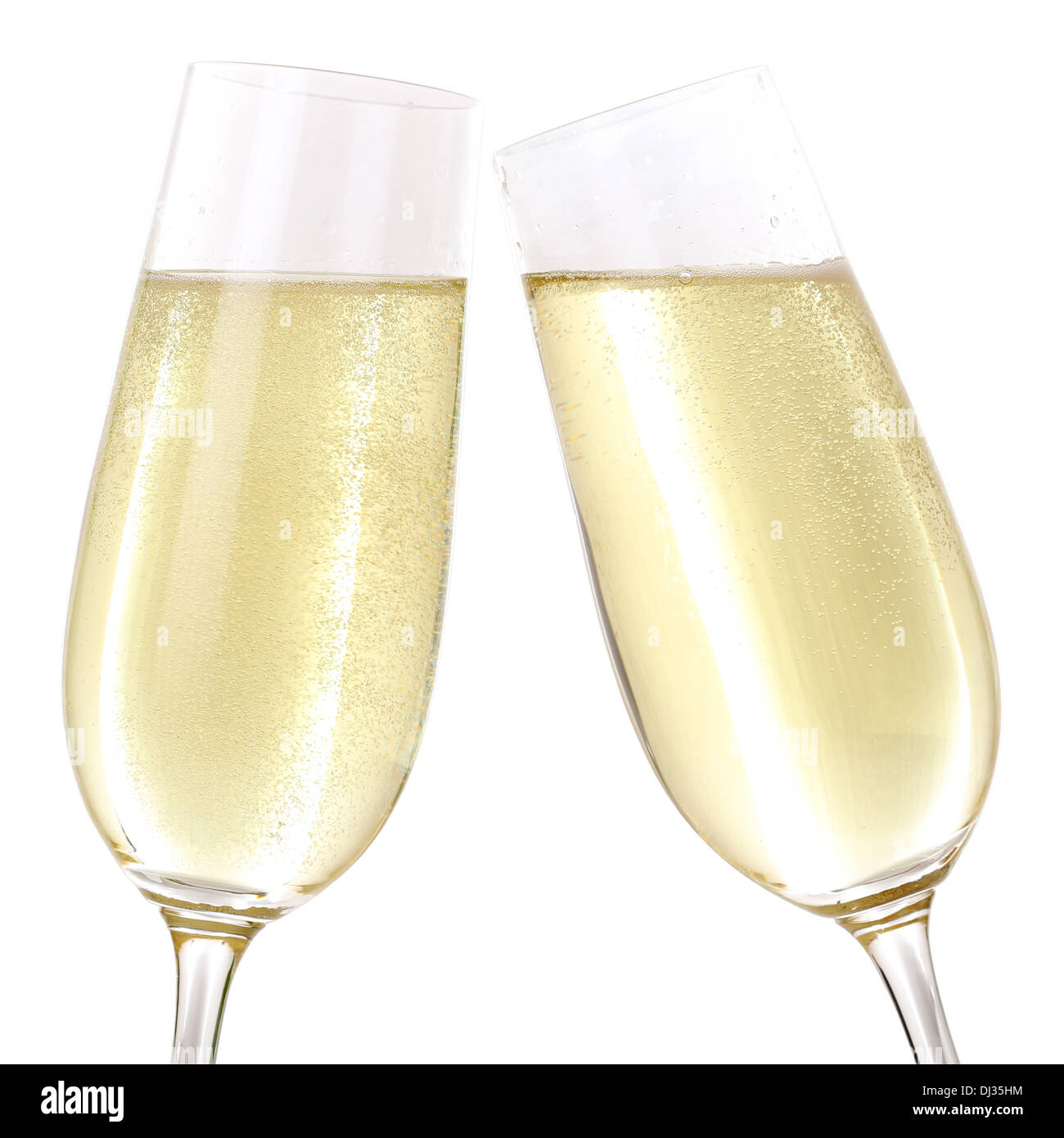 Clink glasses with two glasses filled with sparkling Champagne - Stock Image
