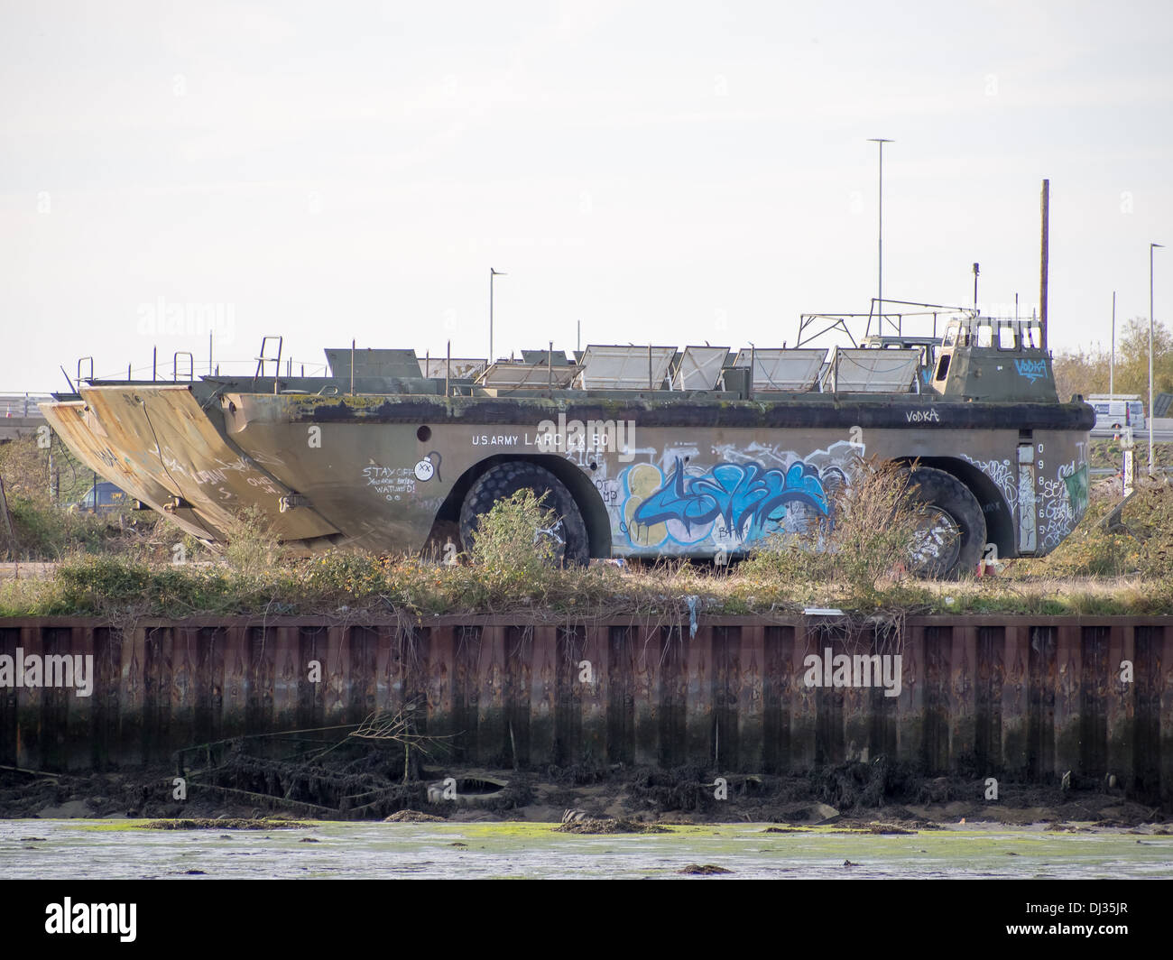 LARC-LX (Lighter, Amphibious Resupply, Cargo, 60 ton) with Graffiti sitting in Harry Pounds scrapyard, Portsmouth. - Stock Image