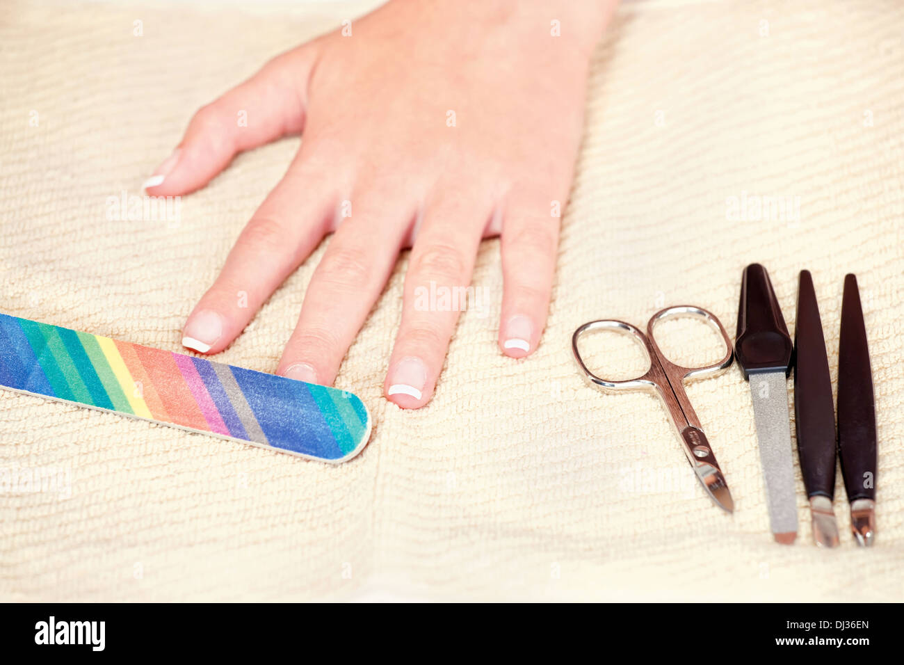 Nails beauty treatment with nail file - Stock Image