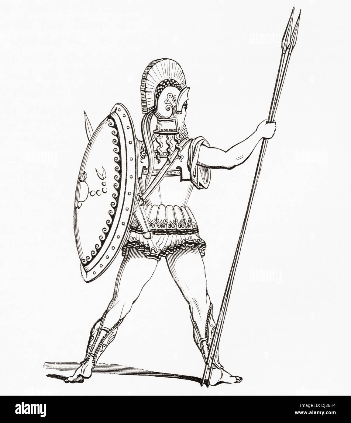 Heavily armed Greek warrior dressed for battle. - Stock Image