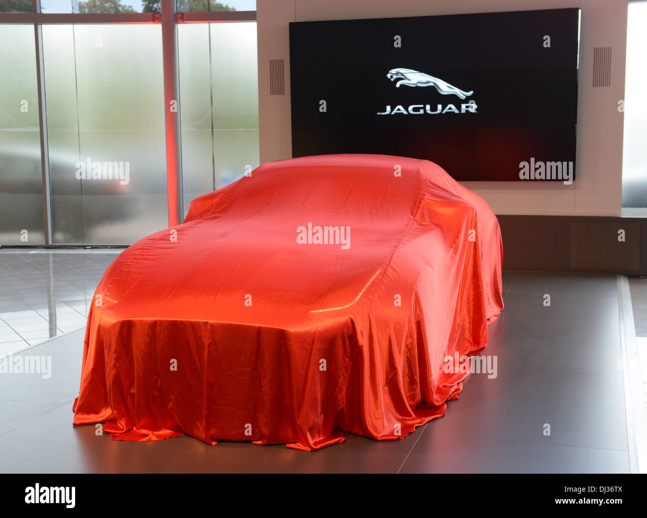 New Jaguar F Type under wraps before its launch - Stock Image
