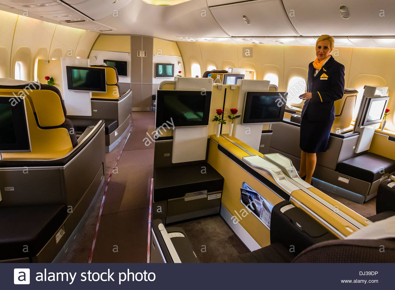 First class cabin of a Lufthansa 747 jet at Frankfurt Airport, Germany. - Stock Image