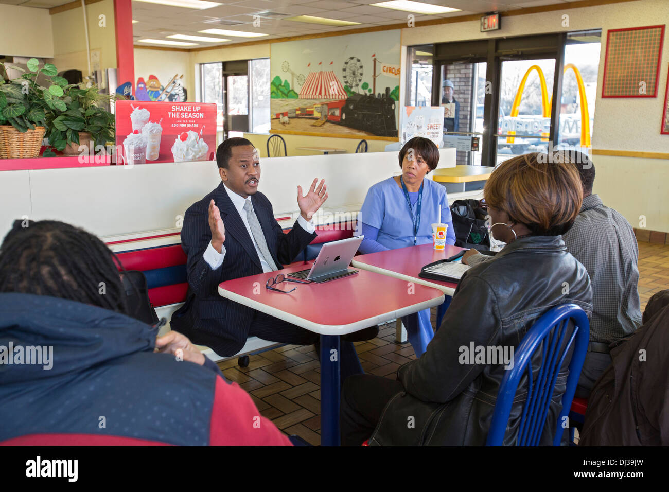 Politician holds 'coffee hour' to discuss concerns of constituents - Stock Image
