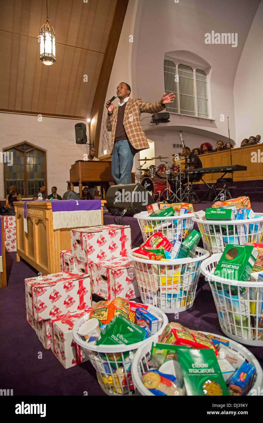 State Representative Gives Away Thanksgiving Food Baskets to Constituents - Stock Image