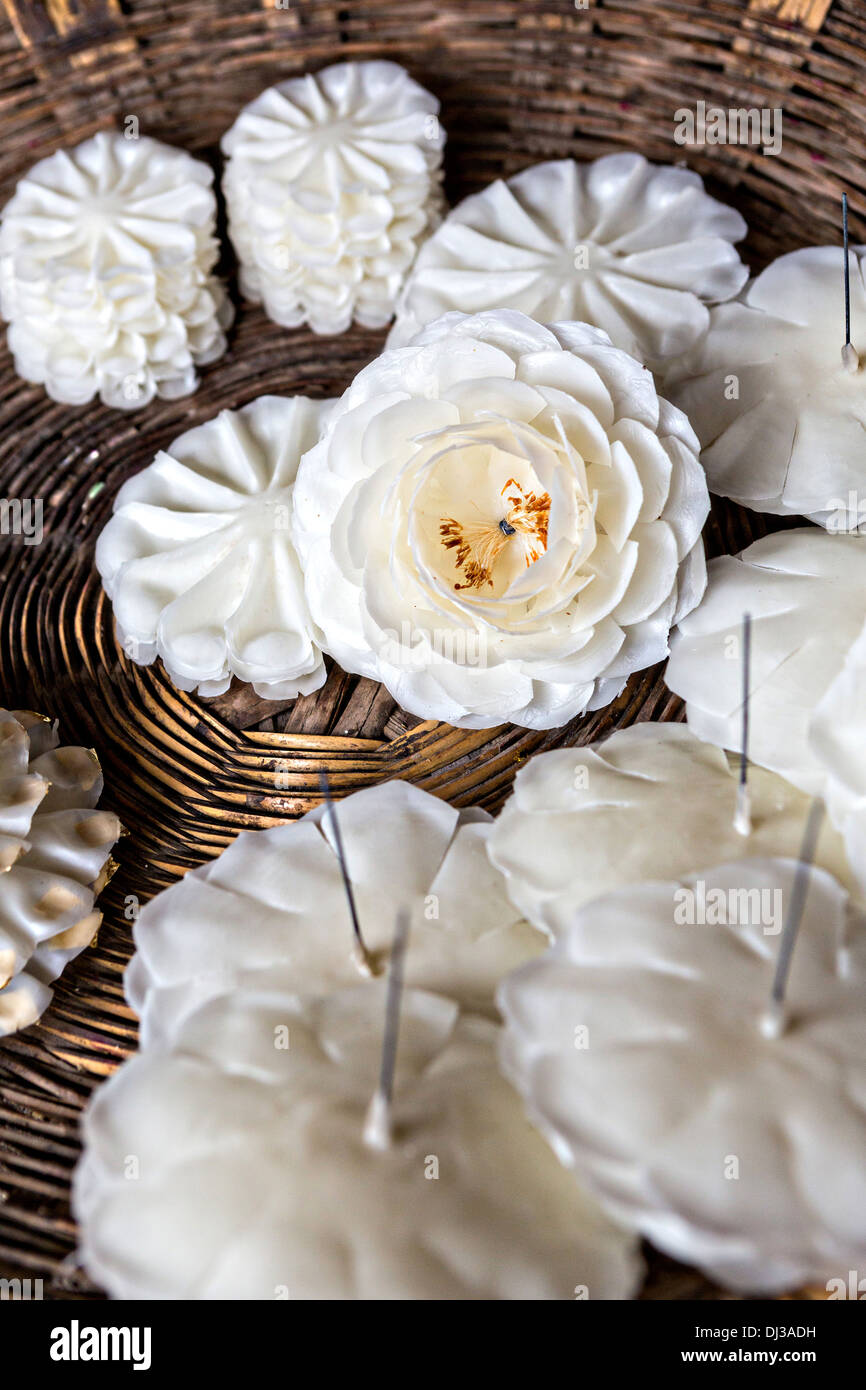 Traditional hand made beeswax flowers wait to be attached to candles in preparation for the Day of the Dead festival. - Stock Image