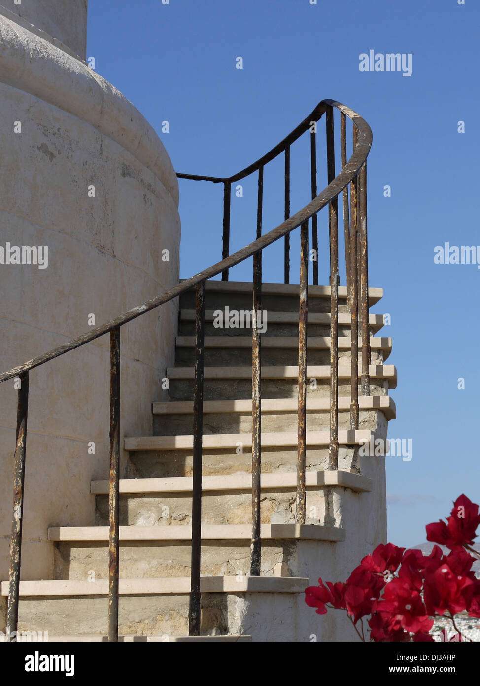 Steps and handrail at base of lighthouse. - Stock Image