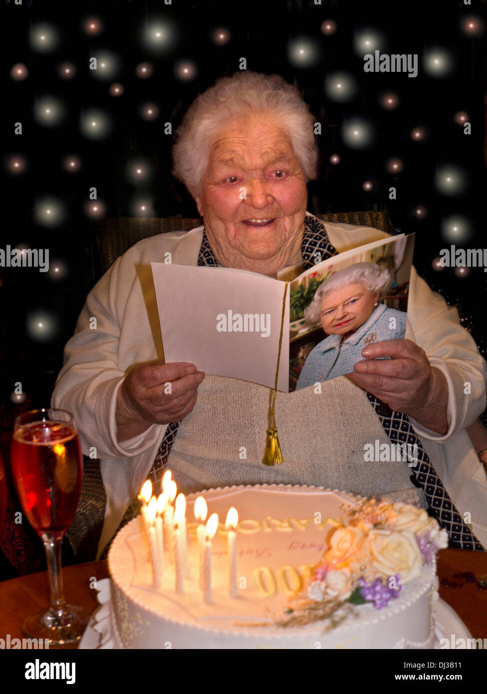 Happy Alert Elderly Lady At 100 Years Of Age With Her Birthday Cake And The Traditional