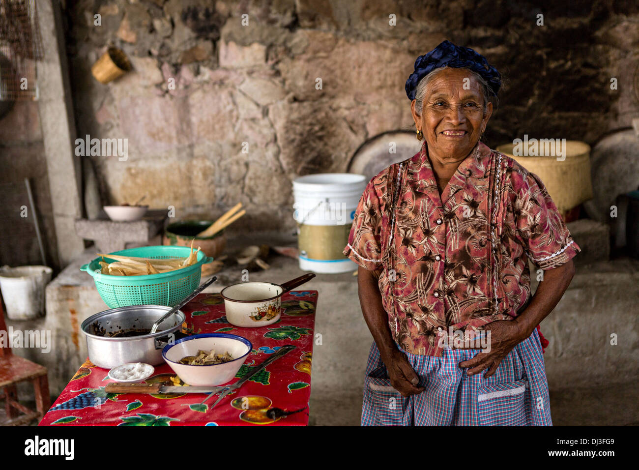 An elderly Zapotec indigenous woman poses in her kitchen in Teotitlan, Mexico. - Stock Image