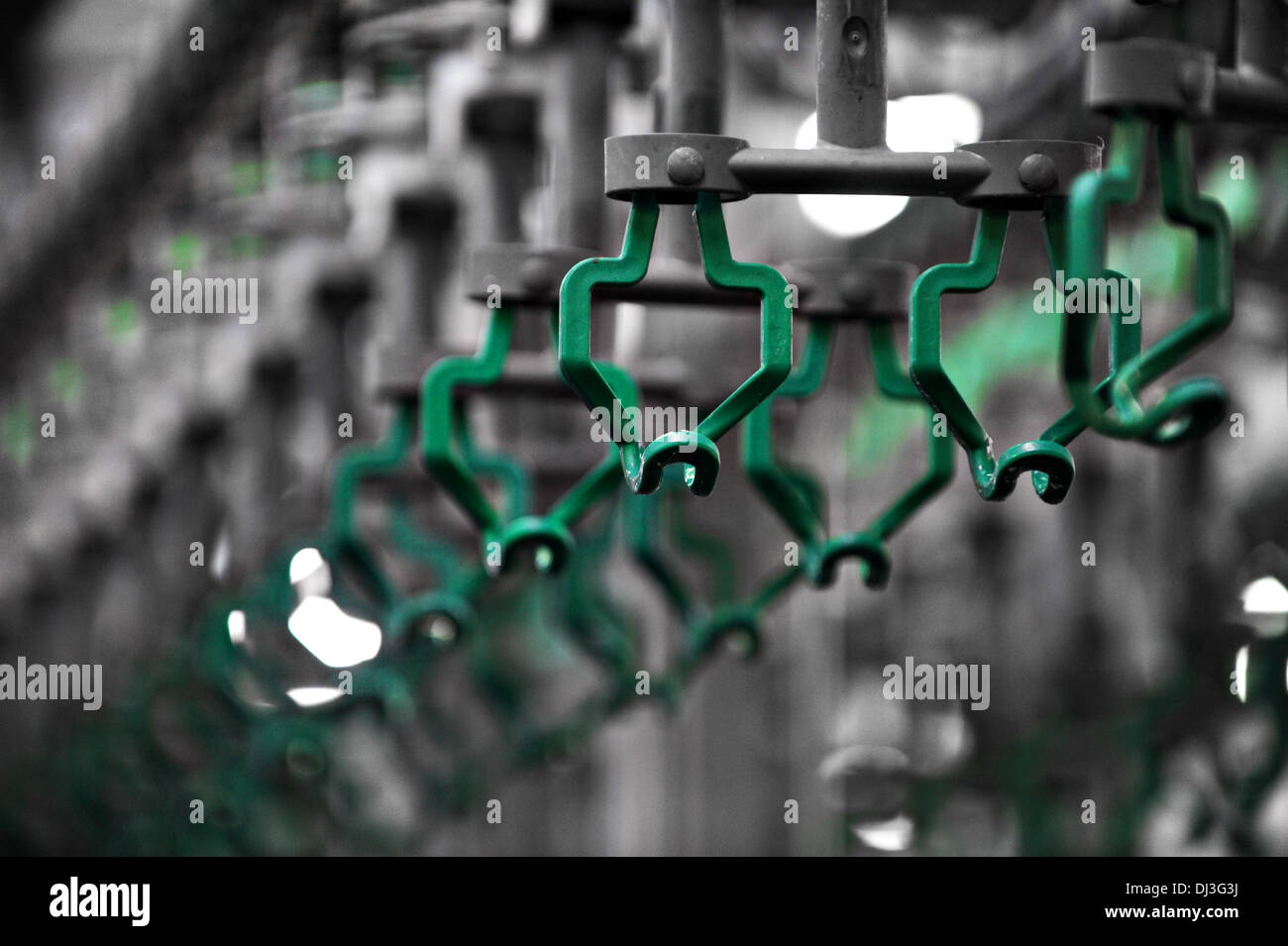 Empty hooks in a poultry meat processing factory - Stock Image