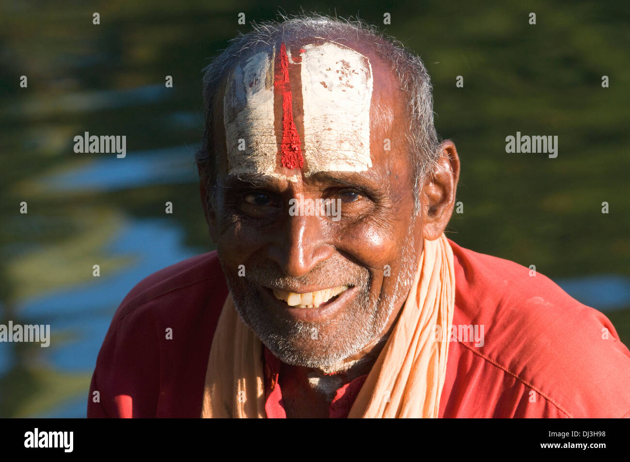 Sadhu, Indian holy man and renunciant and devotee of Lord Vishnu shown here with the style of adornment on his forehead - Stock Image