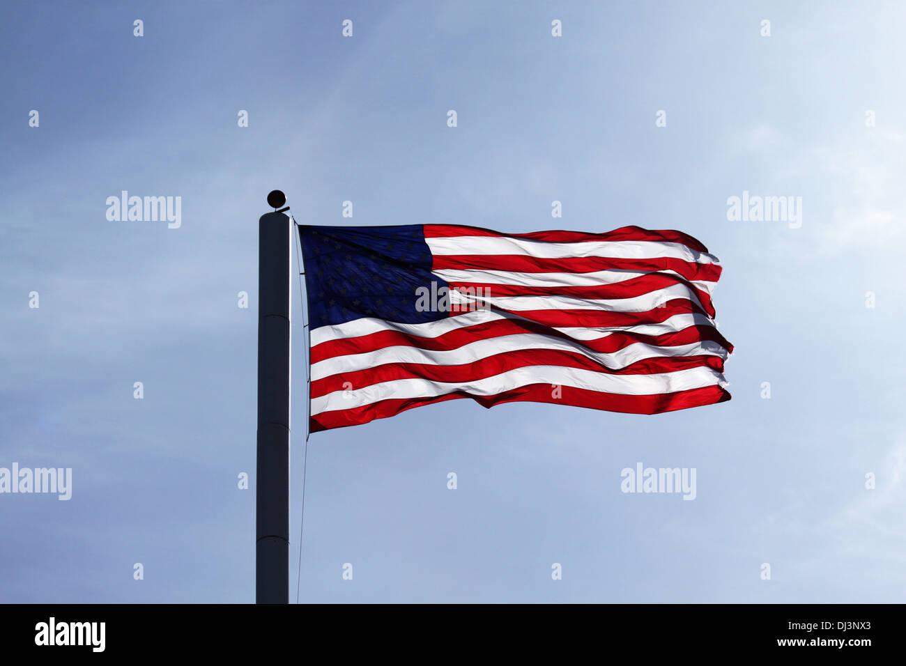 Waving American Flag on A Flagpole - Stock Image