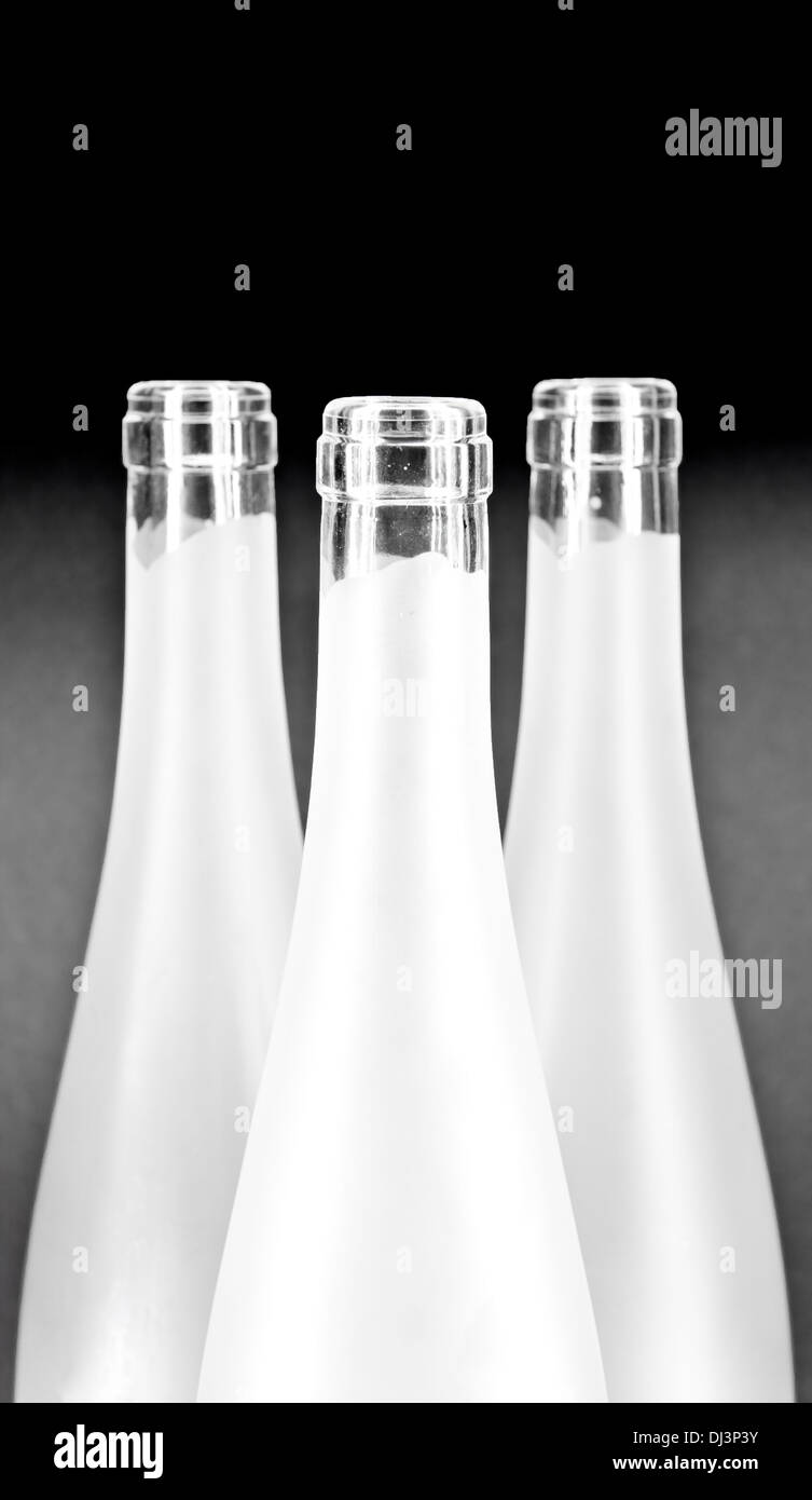 White wine bottles bottle necks on dark background Stock Photo