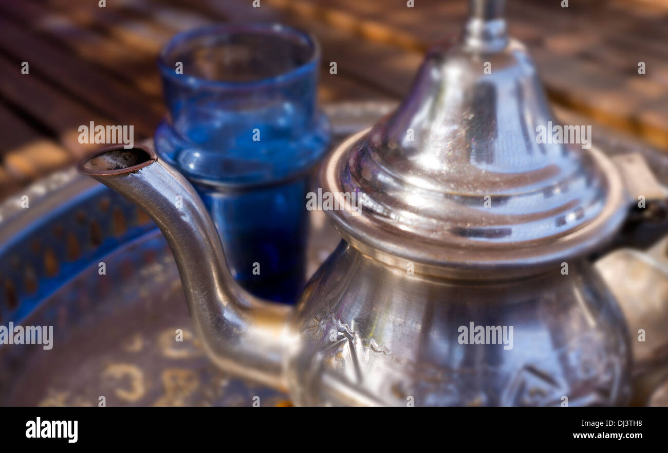 Silver Tea pot and glass of Mint tea, Marrakech, Morocco, North Africa - Stock Image