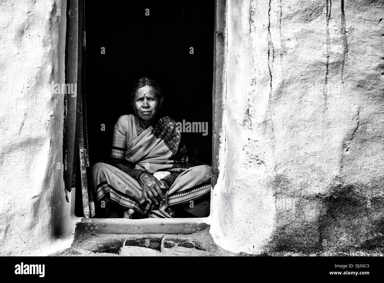 Elderly indian woman sitting in her doorway of her rural village home andhra pradesh india black and white tim gainey alamy stock photo