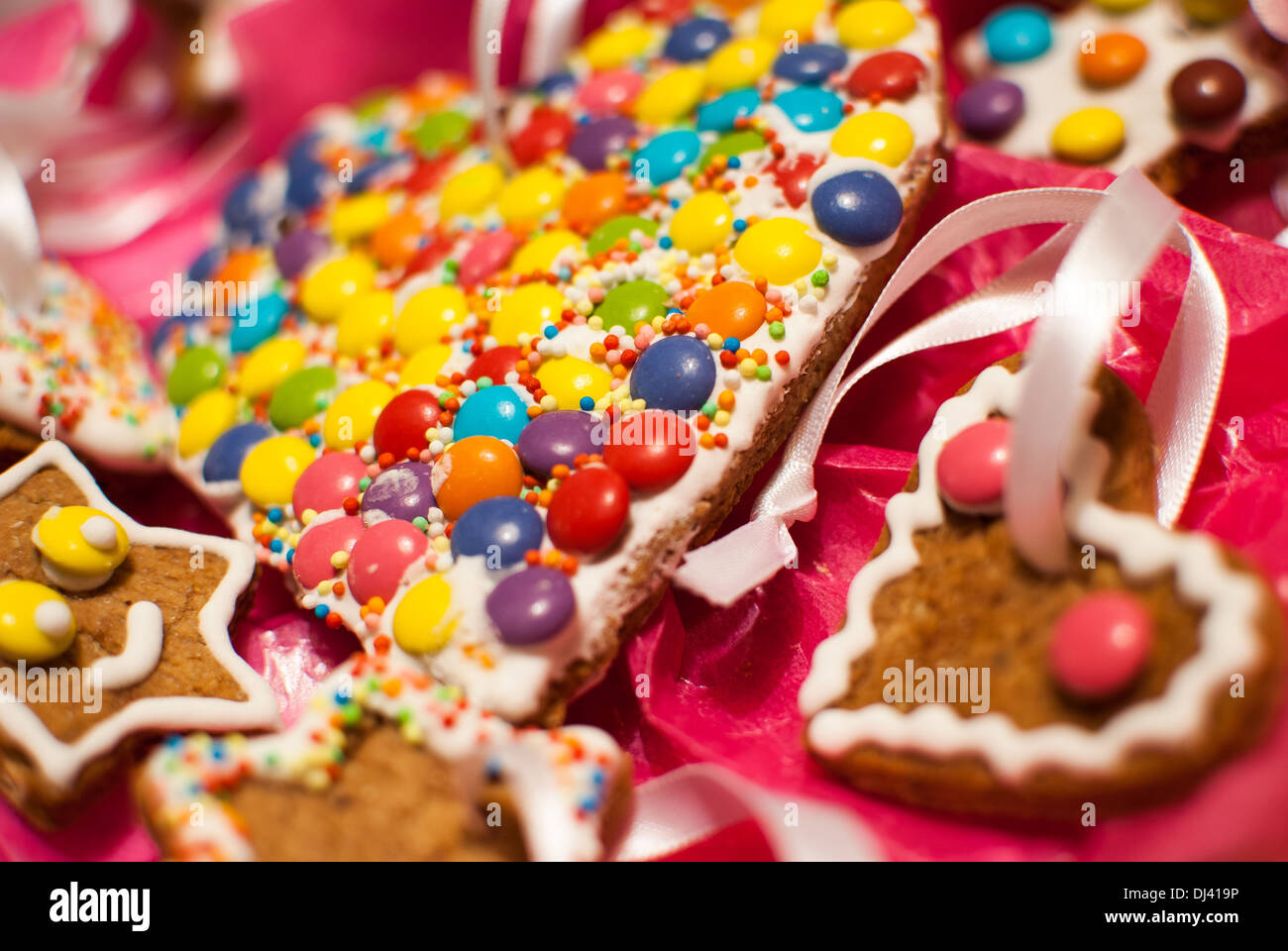 Detail of Christmas holiday heart shape M&M's like cookies - Stock Image