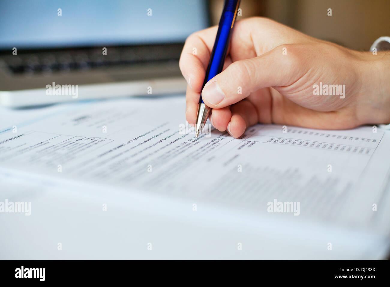 tax form analyzing - Stock Image
