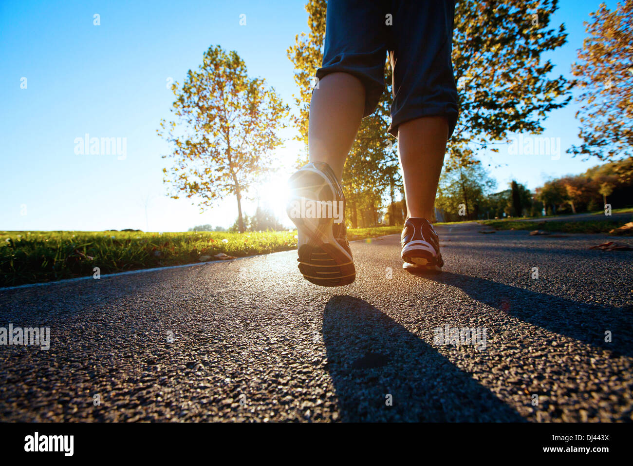 sport background, runner feet on road closeup - Stock Image