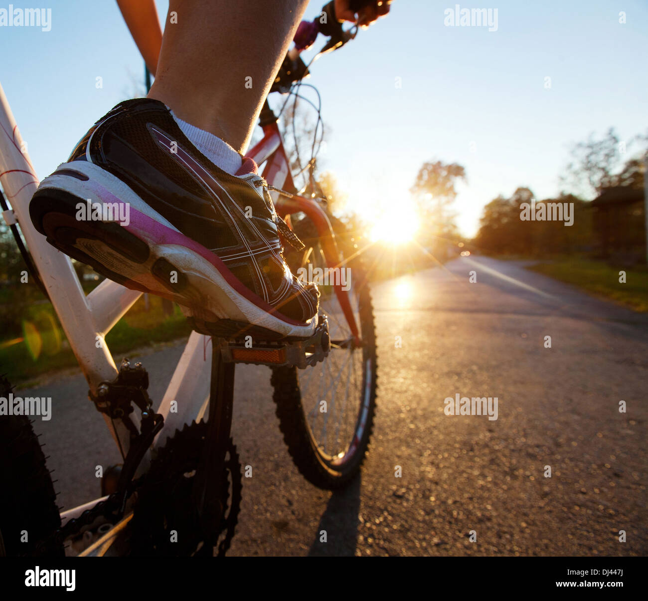 foot on pedal of bicycle - Stock Image