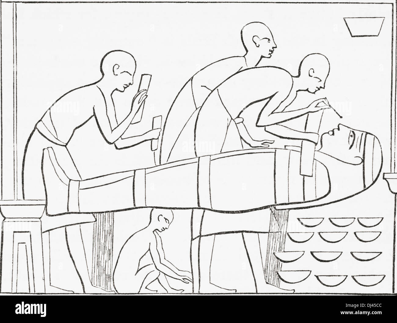 Ancient Egyptians painting the Cartonage or outer case of a mummy. - Stock Image