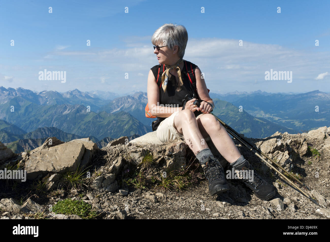 Woman sitting on the top of the fog horn - Stock Image