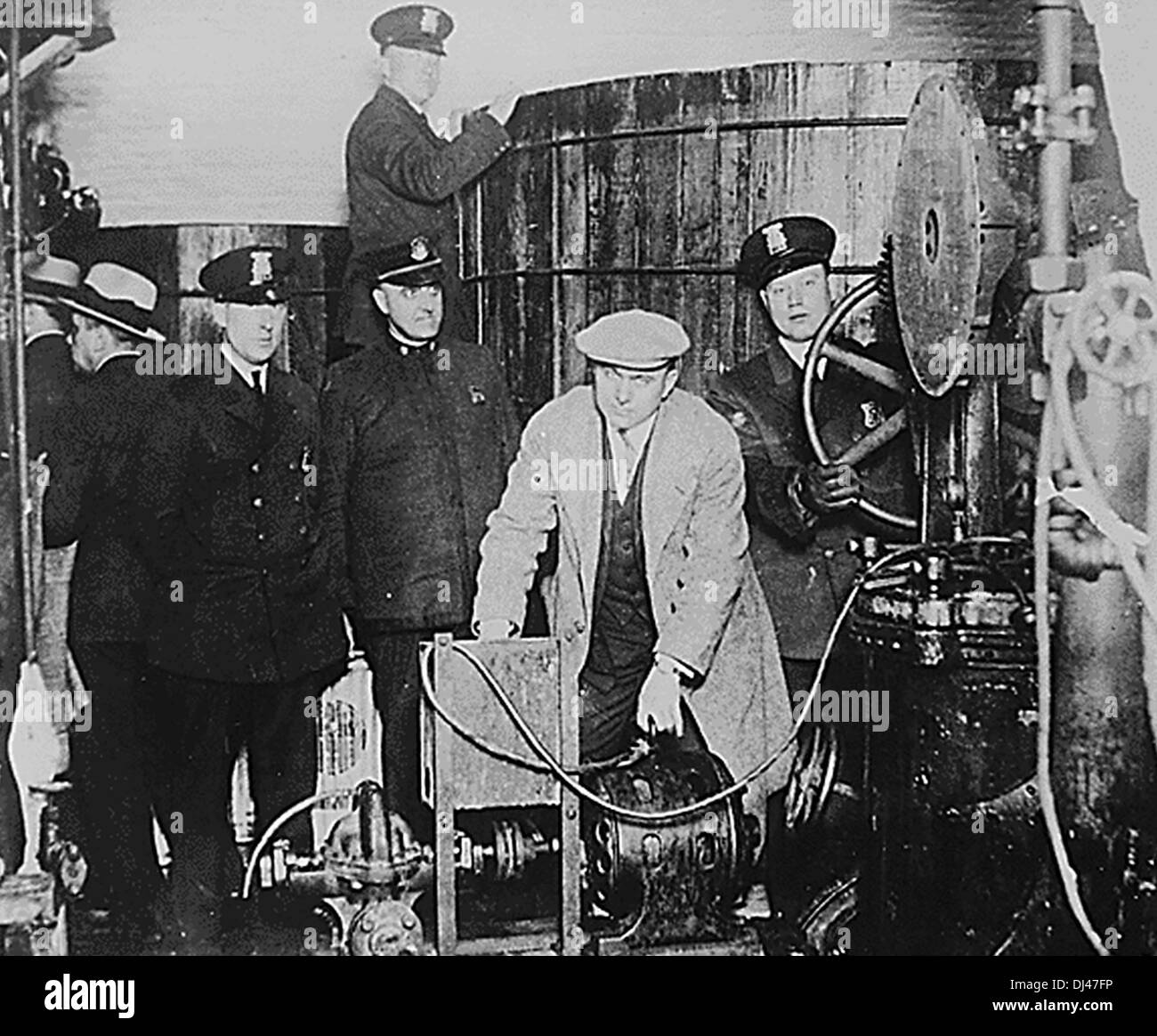 Detroit police inspecting equipment found in a clandestine brewery during the Prohibition era - Stock Image