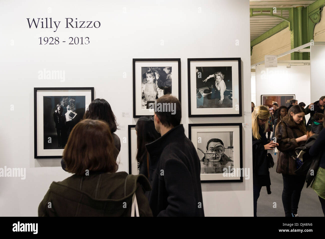 Stand at Paris Photo 2013, art fair at le Grand Palais in Paris, France. Visitor looking Willy Rizzo photography. - Stock Image
