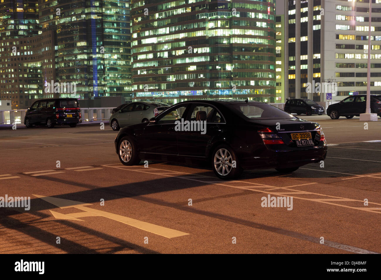 Luxury cars on a parking lot in the city of Hong Kong - Stock Image