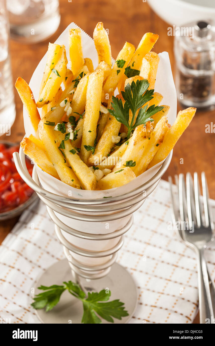 Garlic and Parsley French Fries with Ketchup - Stock Image