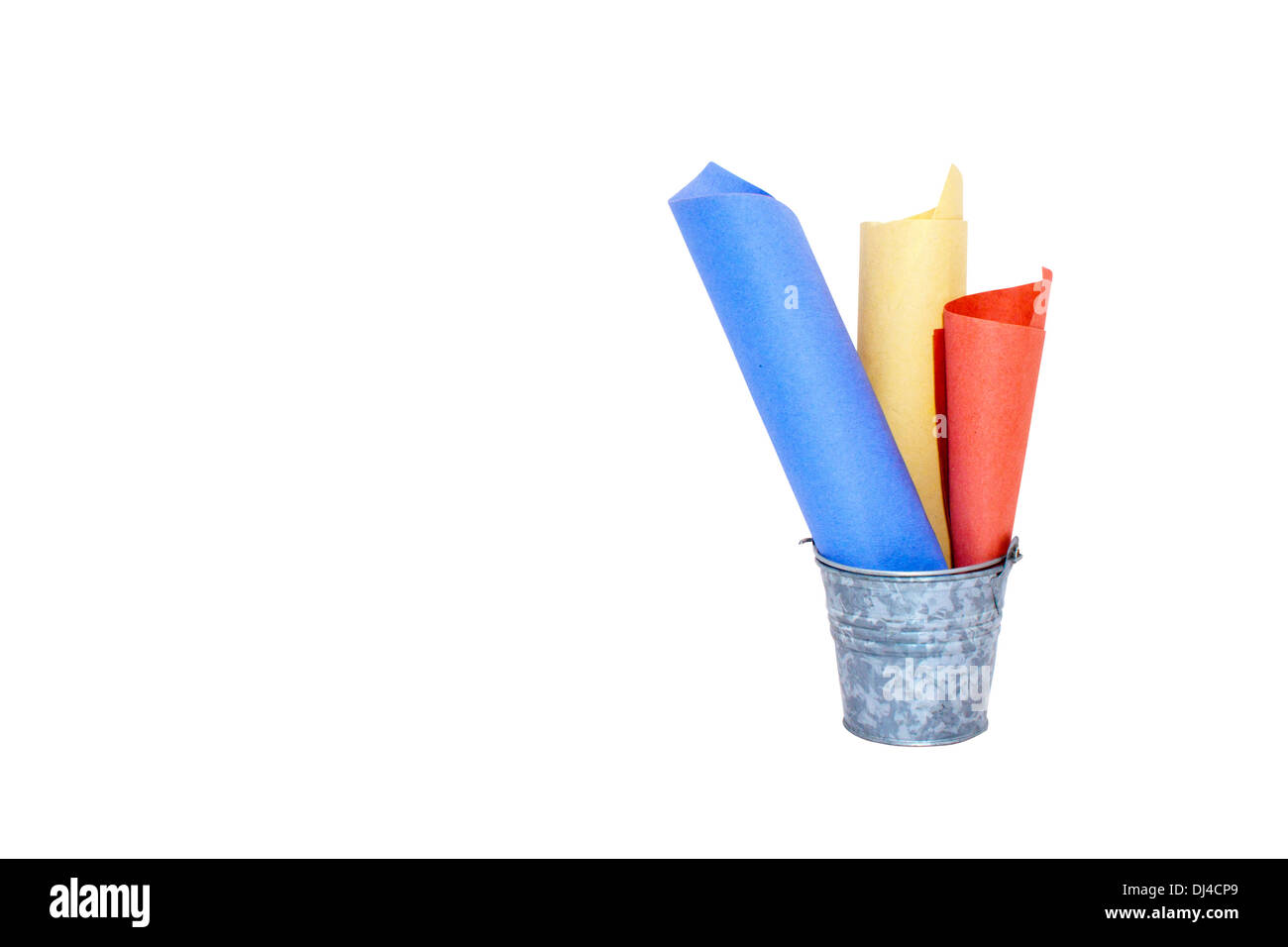 galvanized bucket containing three rolled colored paper lists - Stock Image