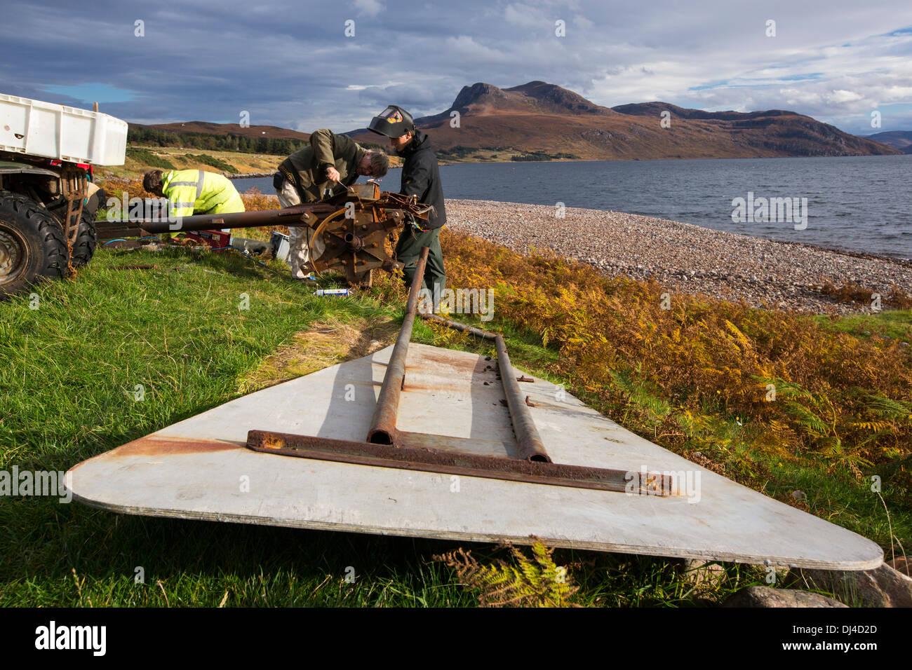 Hugh Piggott doing maintenance on his home made wind turbines in Scoraig, in NW Scotland, a remote off grid, communitiy, UK - Stock Image