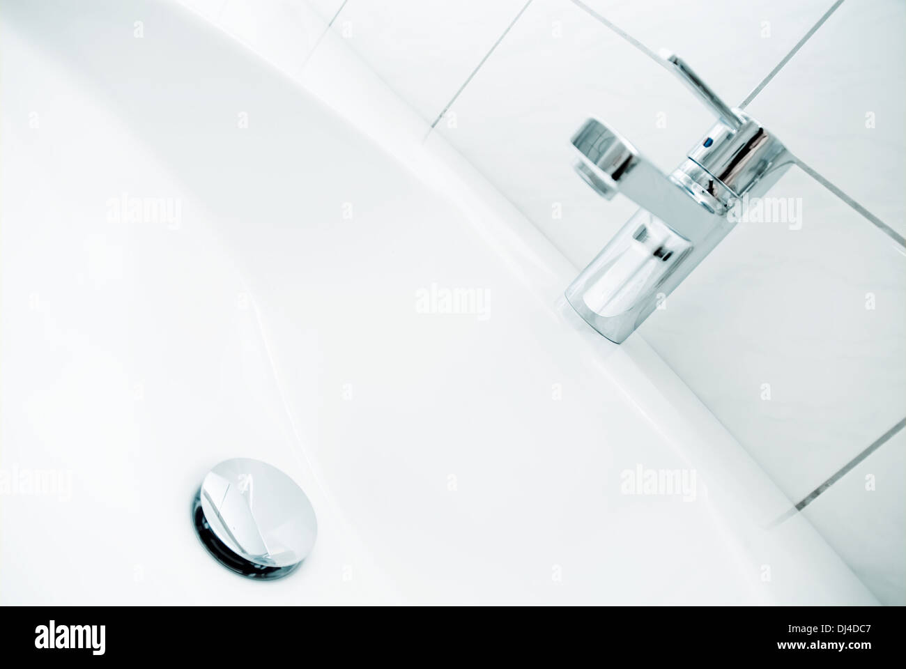 Sink with faucet and drain Stock Photo