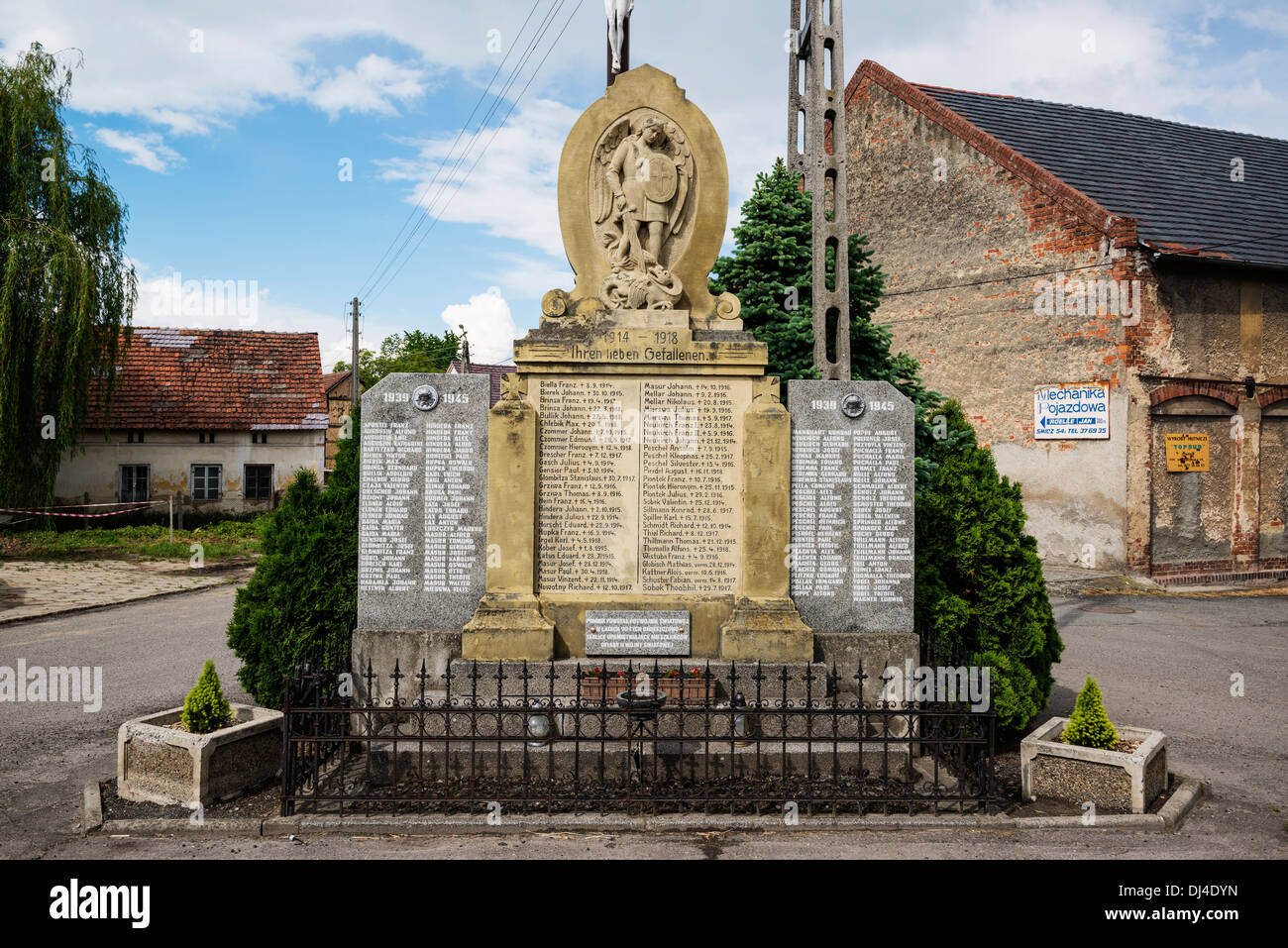 German - Polish WW1 and WW2 war memorial stone, Formerly Schmitsch, Oberschlesien, Germany, Now Scmicz, Opole Voivodship, Poland - Stock Image
