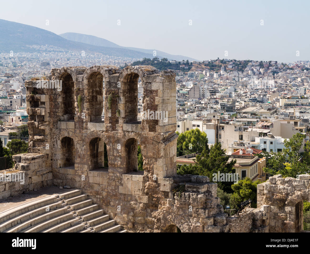 The Odeon of Herodes Atticus amphitheatre from the Acropolis, Athens - with the old ancient Greece city behind - Stock Image