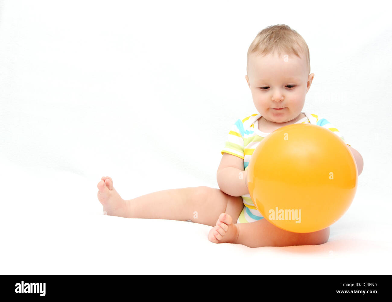 little baby with balloon - Stock Image