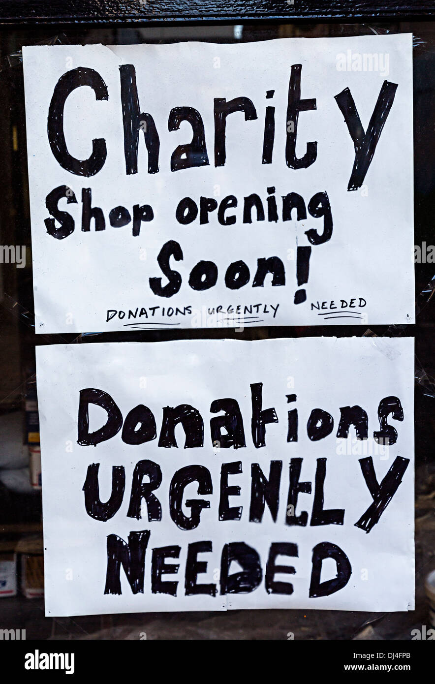 Sign in a charity shop window asking for donations, Republic of Ireland - Stock Image