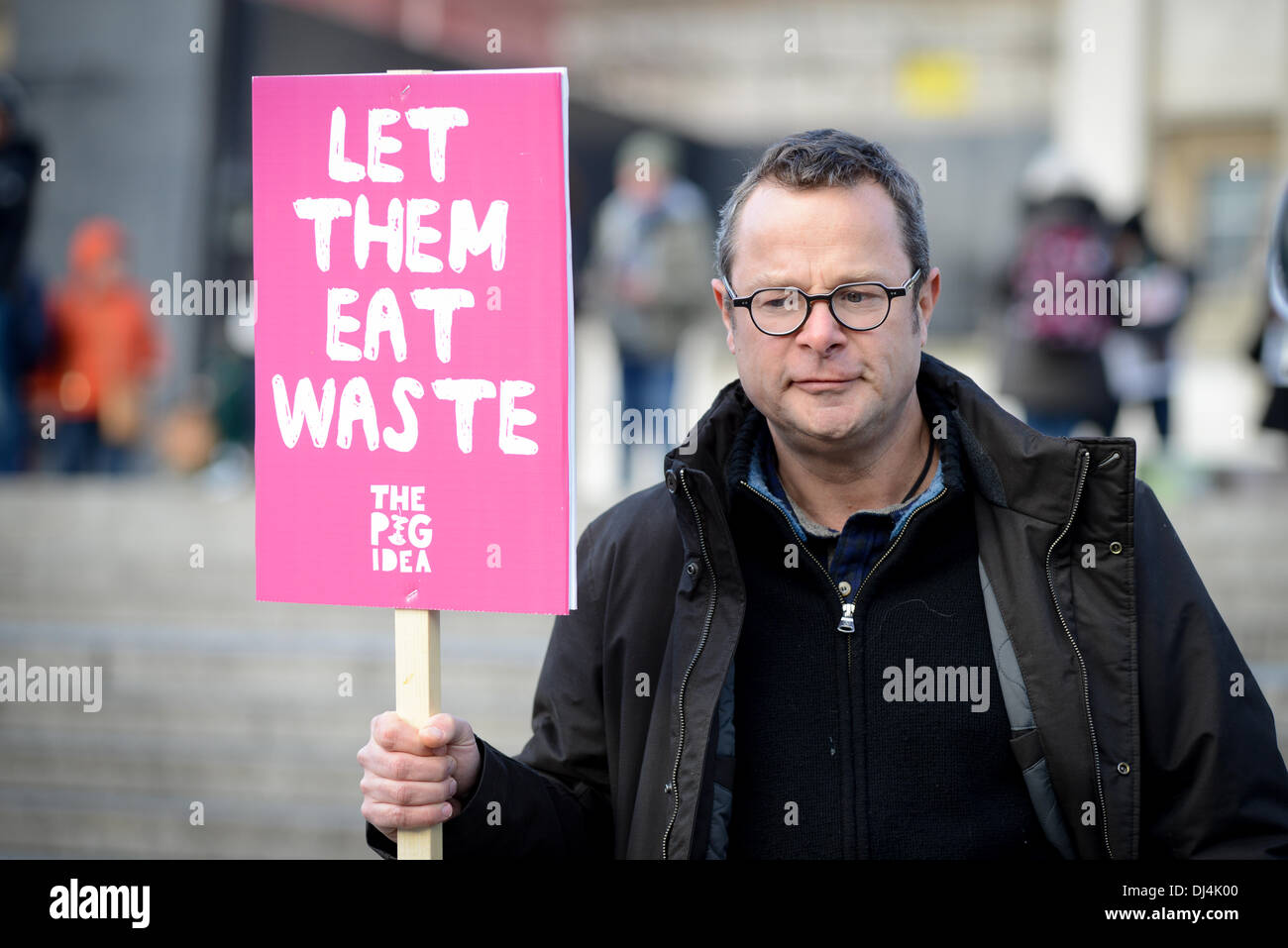 Hugh Fearnley- Whittingstall with a sign ' Let them eat waste' at The Pig Idea feast in Trafalgar SquareThe Pig Idea feast in Trafalgar Square - Stock Image