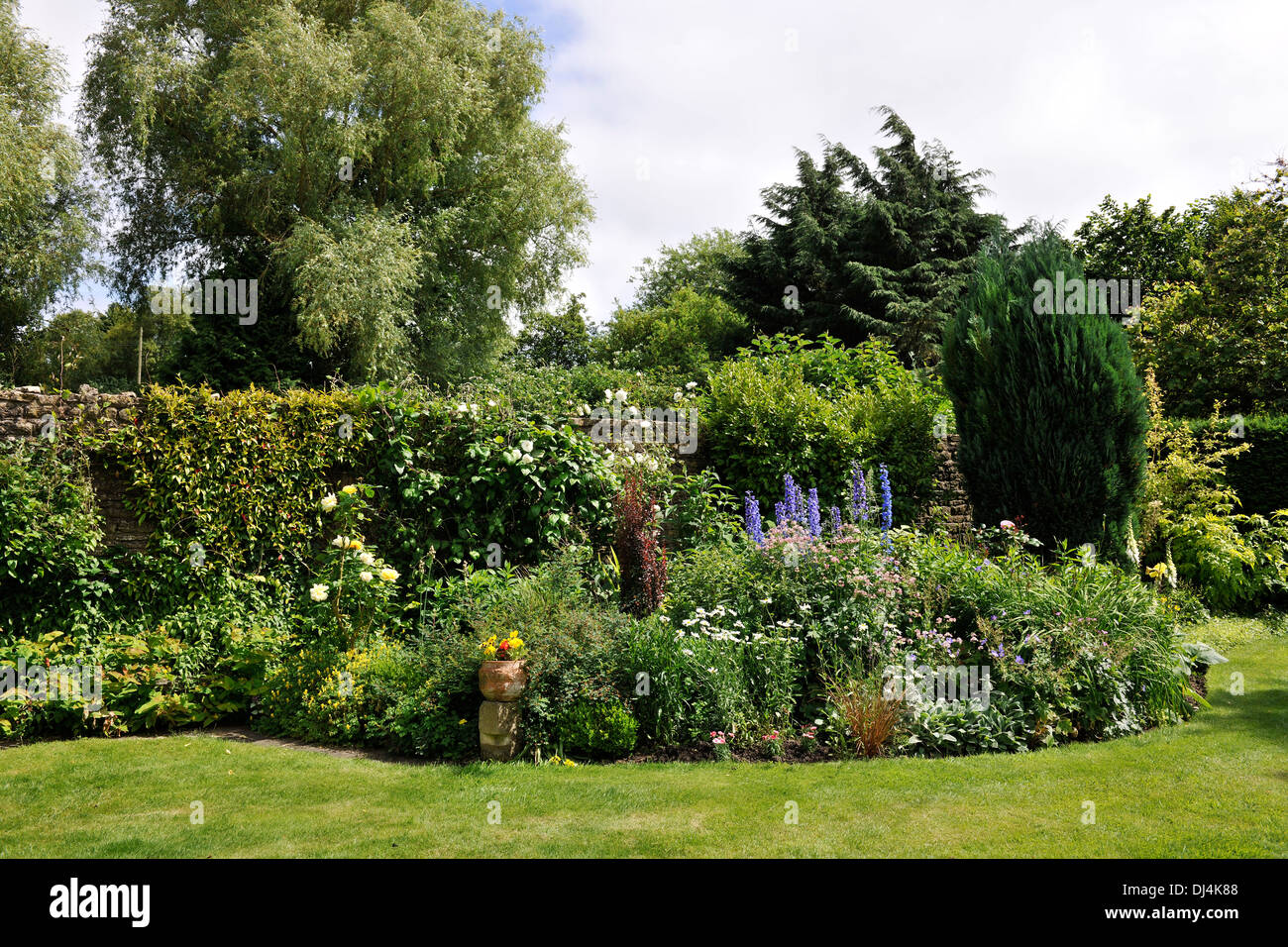 Private garden in the small village of Nunney, Somerset, an English Garden in rural Somerset - Stock Image