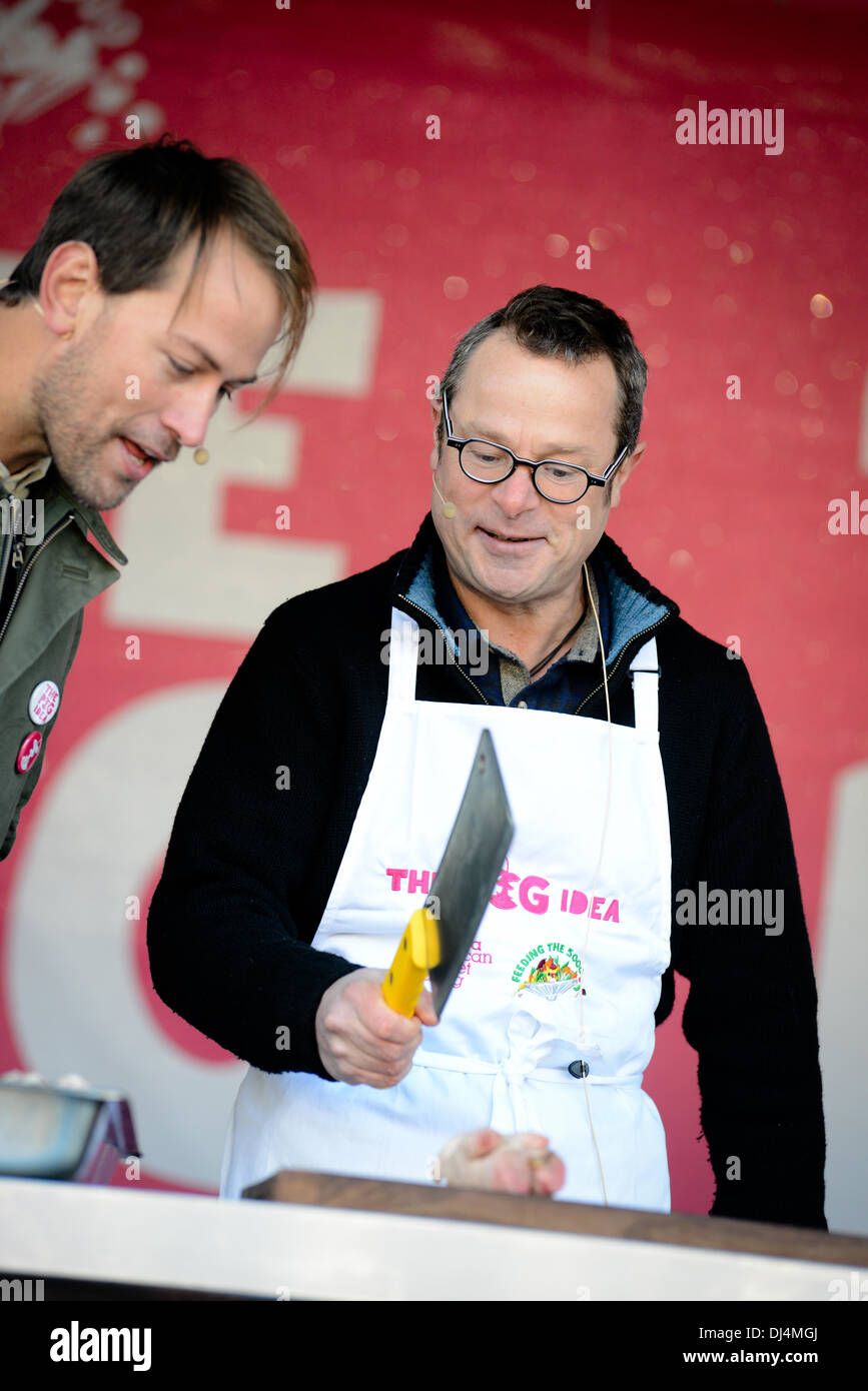 Hugh Fearnley- Whittingstall cooking pig trotters on stage at The Pig Idea feast in Trafalgar Square - Stock Image
