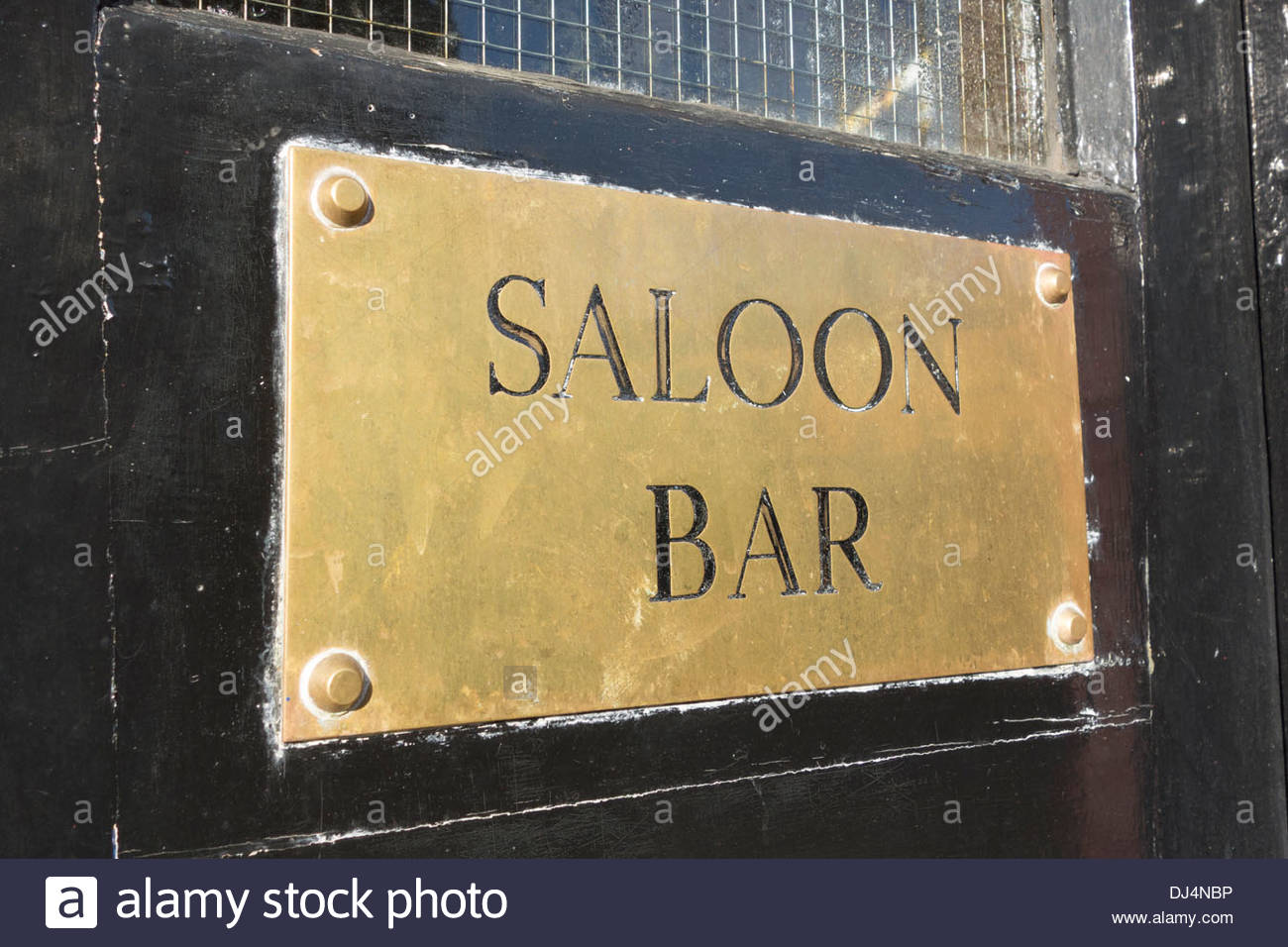 Saloon bar sign on an etched brass plate - Stock Image