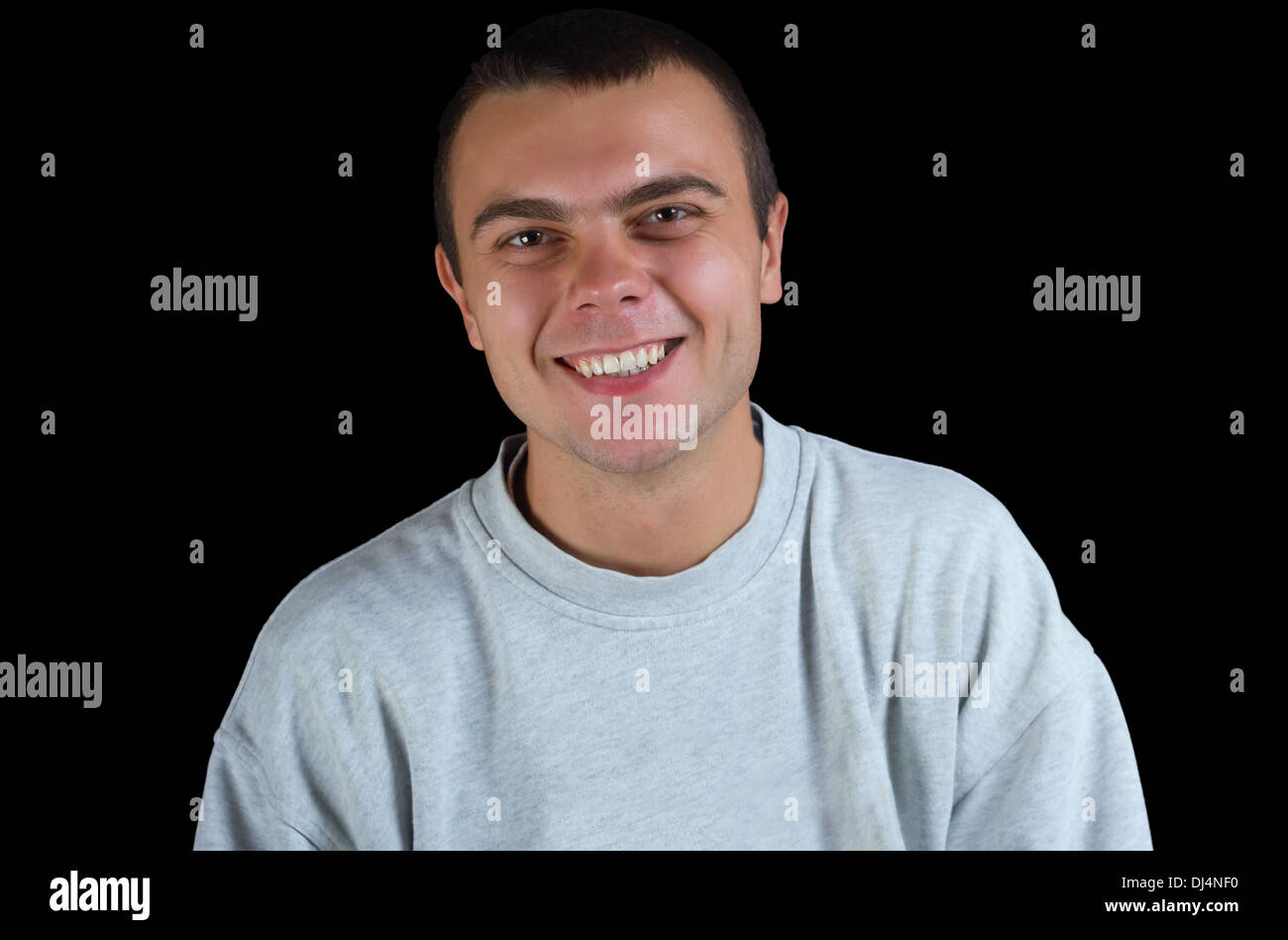 young guy in a track suit on a black background - Stock Image